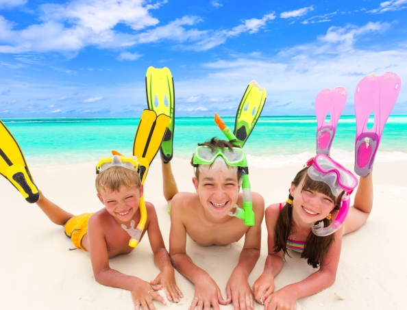 Children with snorkels by sea